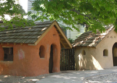 The cob playhouses, built by many hands