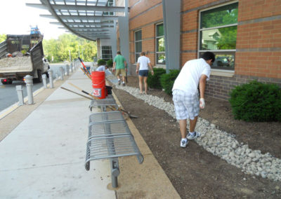 Moving literally tons of gravel into the bioswale.